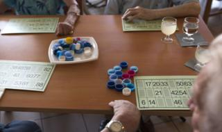 A file photo of elderly people in a care home playing Lotto