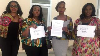 Members of the Media Alliance for women in media in Ghana holding up #Justice4Her slogans