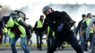 Protesters wearing yellow vests clash with French riot police during a demonstration in Paris, 16 February 2019