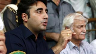 Bilawal Bhutto speaks to journalists as he campaigns ahead of the 2018 election