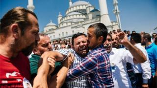 A man cries during the funeral ceremony of Sehidmiz Murat Inci, victim of the coup attempt, at Kocatepe Mosque in Ankara (July 18, 2016)