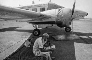 A security guard sits on charpoy at the Juhu Airport in 1982