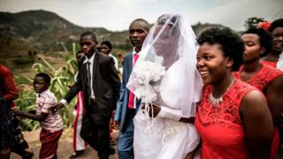 Man and Woman wey just marry dey waka after ceremony for Rwanda