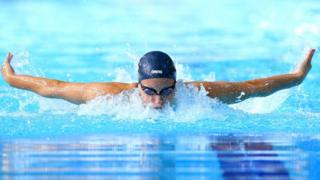 Sophie Allan competing in 200m individual medley at Glasgow Commonwealth Games