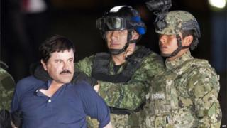 "Joaquin ""El Chapo"" Guzman faces the media in handcuffs following his capture by Mexican soldiers and marines six months after he escaped from jail. (8/01/16)"
