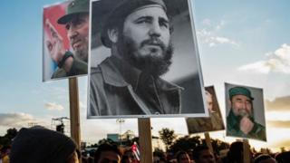 People gather before the start of the last ceremony to pay homage to the late Cuban leader Fidel Castro in Santiago