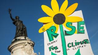 "A hand-drawn sunflower on a ""Rise for the Climate"" poster during the ""March for the climate"", in Republic Square, Paris, France on 8 September 2018"