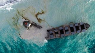 An aerial view taken in Mauritius on August 17, 2020, shows the MV Wakashio bulk carrier, belonging to a Japanese company but Panamanian-flagged, that had run aground and broke into two parts near Blue Bay Marine Park.