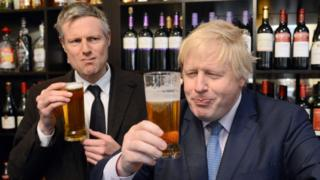 Zac Goldsmith holding a beer glass in a strange way