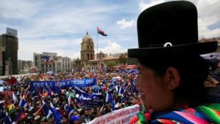 "An Aymara woman, supporter of Bolivia's President Evo Morales, attends a meeting on a bid to declare President Evo Morales"" indefinite re-election, in La Paz, Bolivia, November 7, 2017."