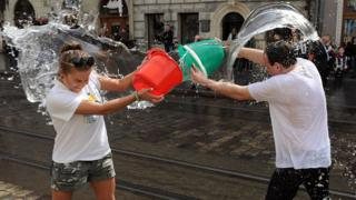 People throwing water on each other.