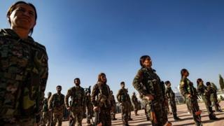 Mourners attend a funeral, for Kurdish political leader Hevrin Khalaf and others in the Kurdish town of Derik on 13 October 2019.