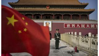 A solider stands in front of Tiananmen Gate in Beijing