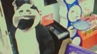 Robber in a panda onesie