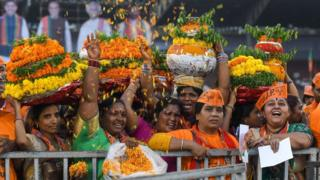 Female BJP supporters throw flowers