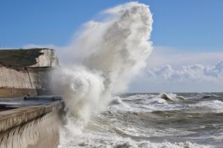 A wave crashing on a beach