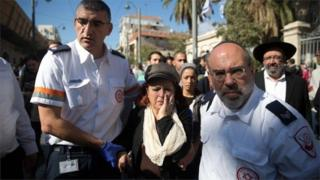 Israeli woman helped from scene of stabbing attack in Jerusalem (23/11/15)