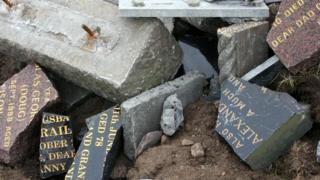 Gravestones in rubble