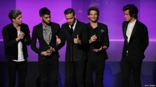 1D at the 2013 America Music Awards accepting their award for favourite pop/rock album for 'Take Me Home'