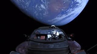 In a photo from SpaceX, a Tesla roadster launched from a rocket with a fictional driver named Starman on his way to Mars