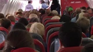 Police escorting passenger off flight