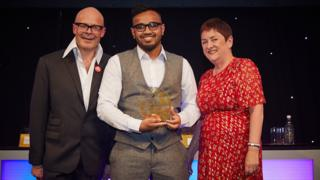 Abed Ahmed at the awards between comedian Harry Hill and TES editor Ann Mroz
