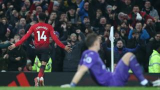 Lingard celebrating to the crowds.