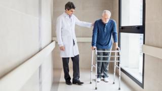 man using walking aid