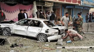 Afghan security officials inspect the scene of an attack by suspected militants at the Indian consulate in Jalalabad, Afghanistan, 02 March 2016