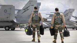 F/A-18F Super Hornet aircrew head to their aircraft in preparation for departure to the Middle East from RAAF Base Amberley on September 21, 2014 in Amberley.