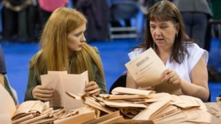 Election workers count votes at the Emirates Arena in Glasgow, Scotland
