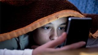 science Child using smartphone