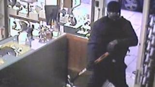 CCTV image of armed robbers