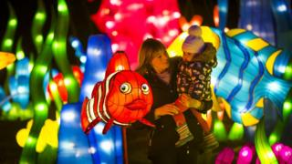 A young girl, her mother and a clown fish lantern