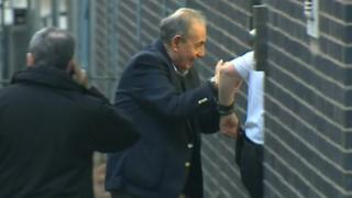 John Allen being led into court