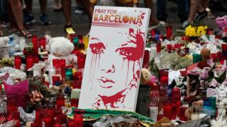 Floral tributes for victims of the Barcelona attack include a sign saying Pray for Barcelona