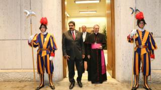 A handout picture provided by Miraflores Press shows Venezuelan President Nicolas Maduro (C-L) being received by Prefect of the Papal Household, German Archbishop Georg Gaenswein (C-R) prior to a private meeting between Maduro and Pope Francis, at the Vatican, 24 October 2016