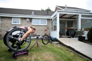 Two wheelchair athletes train outside their homes