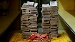 1kg of meat is pictured next to 9.5 million bolivars - its price and the equivalent of $1.45 in Caracas on 16 August 2018