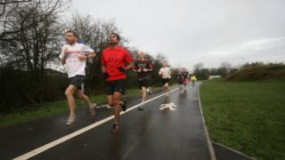 Runners in Little Stoke Park near Bristol