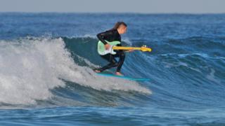 Surfing guitarist