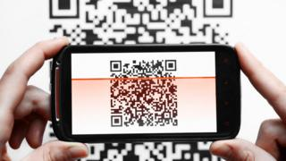 QR code being scanned