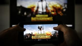 A man plays PUBG game on smartphone in Ankara, Turkey on November 26, 2018