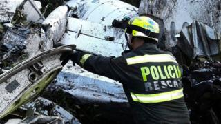 A rescue policeman works at the site of a chartered airplane crash in La Union, a mountainous area outside Medellin, Colombia, Tuesday, Nov. 29, 2016.