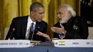 "President Barack Obama talks with India""s Prime Minister Narendra Modi during a working dinner with heads of delegations of the Nuclear Security Summit in the East Room of the White House, in Washington, Thursday, March 31, 2016."