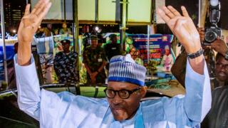 Muhammadu Buhari celebrating his victory