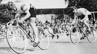 Charles Bazzano (left) is followed by Reg Harris