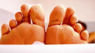 Dedos de los pies arrugados