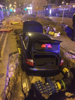 The car landed on the gas main