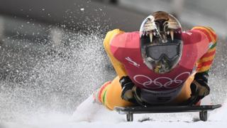 Ghana's Akwasi Frimpong slows down at the end of the men's skeleton heat 1 during the Pyeongchang 2018 Winter Olympic Games, at the Olympic Sliding Centre on February 15, 2018 in Pyeongchang